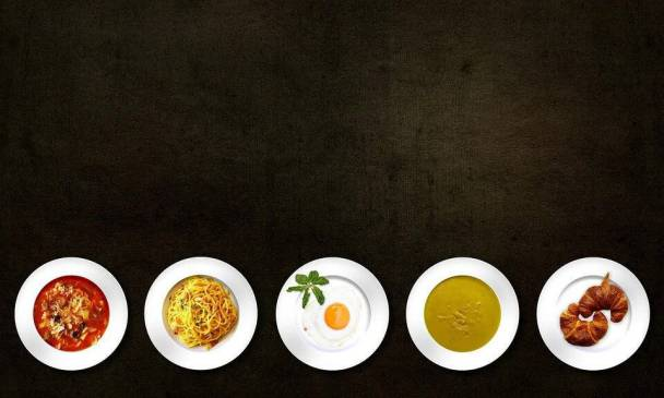 an image of white plates with different dishes
