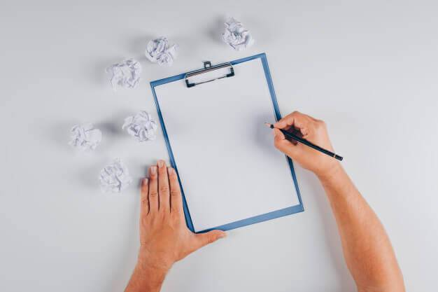 Person writing things on checklist.