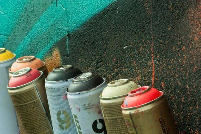 Combustible spray cans.