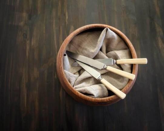 Pot with kitchen utensils.