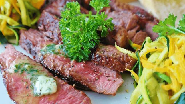 an image of steak with vegetables