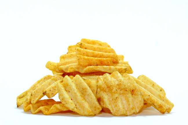 Fried potato chips stacked on top of each other.