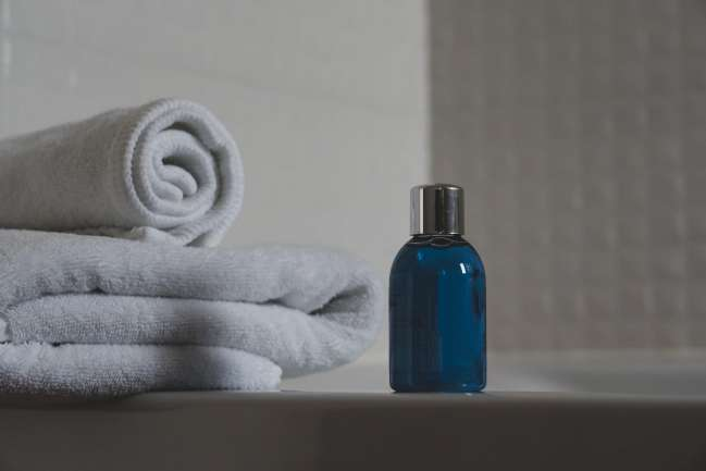 Bathroom towels and bottle.