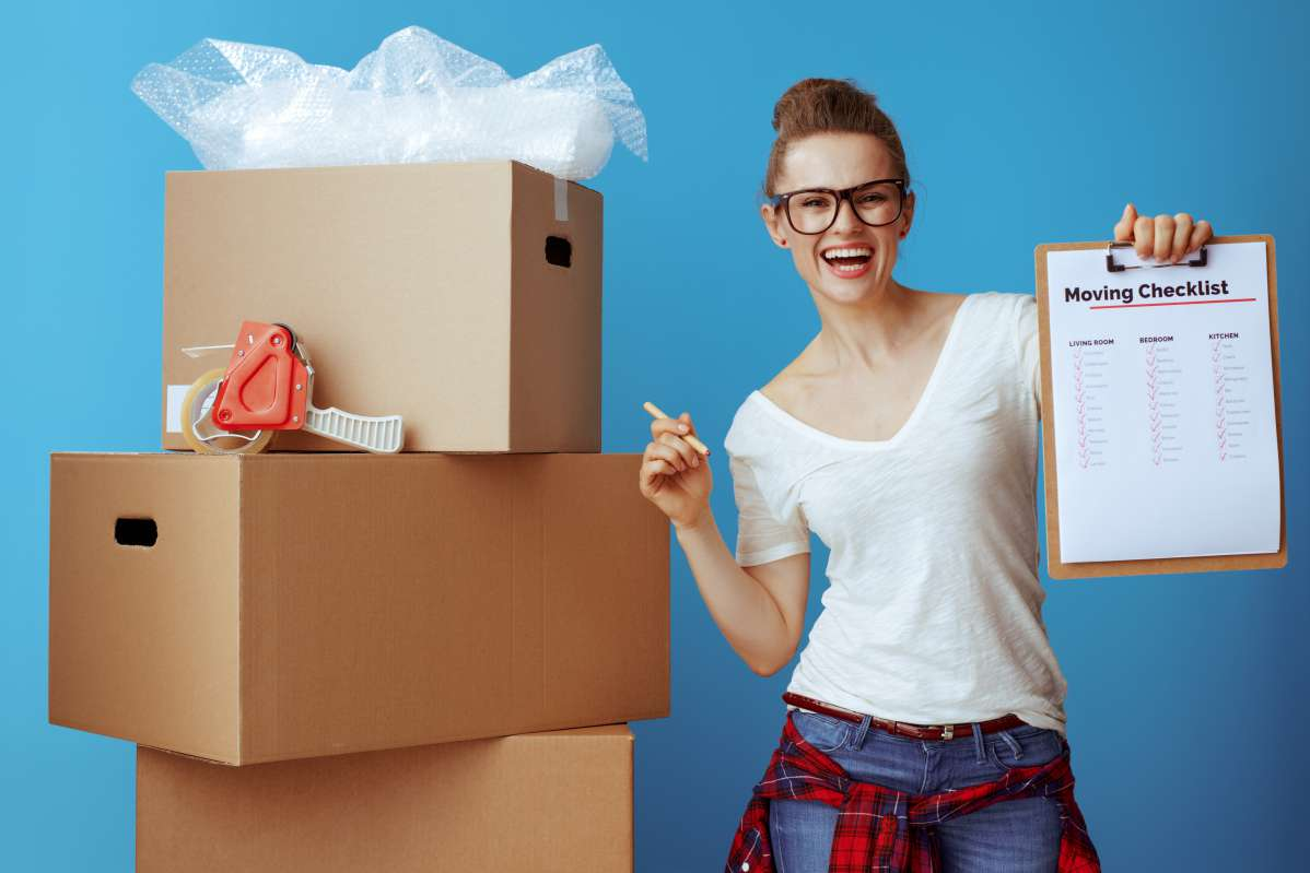 A woman is happy that she hired one of the top moving companies in Seattle, WA